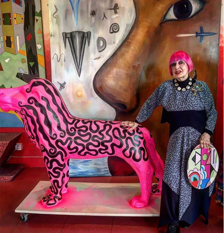 24c2cf01 Iconic fashion designer Dame Zandra Rhodes with her signature pink lion  sculpture at her studios in London.